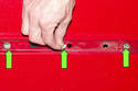 Once the molding has been removed, inspect the rubber body inserts and replace as needed (green arrow).