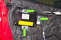 Remove the three 10mm airbag fasteners (green arrows) and move the airbag away from the door.