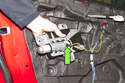 Then disconnect the side airbag electrical connector (green arrow) and remove the airbag from the door.
