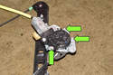 Remove the window motor fasteners and rotate the window motor counterclockwise to remove from the window regulator.