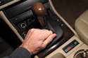 Grab the shift boot at rear and pull the bezel up and out of the center console.