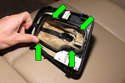 Then unclip the shift boot from the bezel by disconnecting the retaining tabs (green arrows).