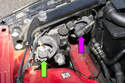 Working at rear of headlight assembly, unplug the headlight bulb electrical connector by squeezing the release tab and pulling it off.