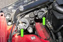 Disconnect the headlight's electrical connectors (green arrows).