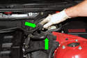 Next, pull the hoses up and out of the trim panel (green arrows).