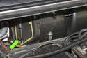 Working at the right side of the wiper cowl, pull the air intake flap lever up (green arrow).