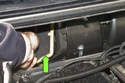 Then remove the right air intake flap (green arrow).