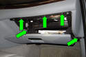 Next, remove the five Phillips-head screws from the glove compartment (green arrows).