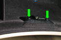 Using a stubby Phillips screwdriver, remove the two screws from the locking panel (green arrows).