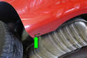 Working under the corner of the bumper, remove the 8mm fasteners (green arrow).