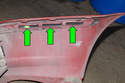 This photo shows the slots on the bumper cover (green arrows).