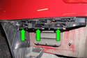 This photo shows the clips on the bumper mounting bracket (green arrows).