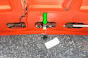 Pull the trim away from trunk lid and locate the trunk release button electrical connector (green arrow).