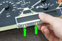 To remove, detach clips at the bottom of the display retainer by pressing the lock away from the cluster circuit board (green arrows).