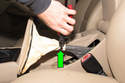 Cut the Zip Tie strap at the base of the parking brake boot (green arrow).