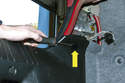 To replace the fender mounted lens, remove the round trim piece to access the lower fastener (yellow arrow).