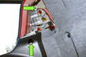 Next, remove the two 10mm mounting fasteners (green arrows).
