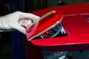 Then remove the taillight lens from the trunk lid by lifting the inside of lens up and unclipping it from the outer edge of the trunk lid.