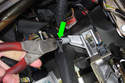 Working at clutch pedal assembly, disconnect clutch pedal return spring using diagonal pliers (green arrow).