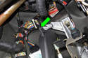 When removing clutch pedal return spring, be sure not to lose rubber insulator (green arrow).