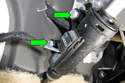 Working at clutch master cylinder (green arrow), remove two 10mm fasteners.