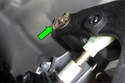 Using a flat-head screwdriver, release clip and remove from clutch pedal shaft (green arrow).