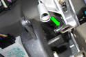 Slide inner bushing on first, then slide pedal back onto shaft (green arrow).