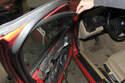 Then, peel back inner door trim from window rail.