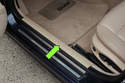 Then remove the front door entrance strip (green arrow) on the side of vehicle you are removing B-pillar trim on.