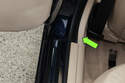 Then working at rear bottom of B-pillar trim, using a plastic prying tool, lever out bottom (green arrow) of B-pillar trim.