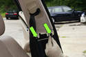 Pull out center of plastic expanding rivets (green arrows) then remove plastic rivets from vehicle body.
