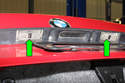 There are two separate license plate bulb lenses (green arrows).