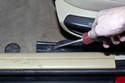 This photo shows how to lever off trim pieces using a flat-head screwdriver.