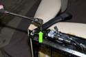 Then remove T50 Torx seat belt buckle fastener (green arrow).