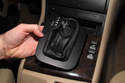 Vehicles with automatic transmission: Once knob is removed, slide boot with bezel off shift lever.