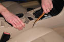 To replace hazard / door lock switch: With bezel removed from vehicle, lift up on center console where cup holders are.