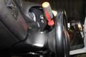 Sport steering wheel: Insert a screwdriver into hole in side of steering wheel.