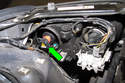 Next, rotate Xenon headlight bulb ignition unit counterclockwise and remove (green arrow).