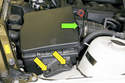 Remove the air filter housing assembly fasteners (yellow arrows) and disconnect air flow meter electrical connector (green arrow).