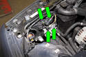 Working at back of headlight assembly, disconnect headlight electrical connectors (green arrows).