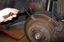 Using a micrometer, measure brake rotor in at least 10 different places.