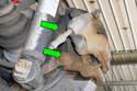 Working behind brake caliper, remove two16mm brake caliper bracket mounting bolts (green arrows).