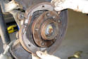 Remove parking brake shoes from vehicle and lay aside.