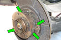 Then lightly grease brake shoe to backing plate contact points (green arrows).