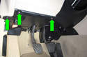Working at trim panel above pedal cluster, remove three Phillips-head screws (green arrows).