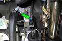Working at front of brake pedal, disconnect brake light switch electrical connector by pressing release tab and pulling off switch (green arrow).