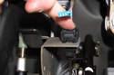 Press brake pedal down, then slide new brake light switch into mounting bracket.