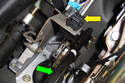 Then, slowly release brake pedal (green arrow) and let it come in contact with brake light switch (yellow arrow).