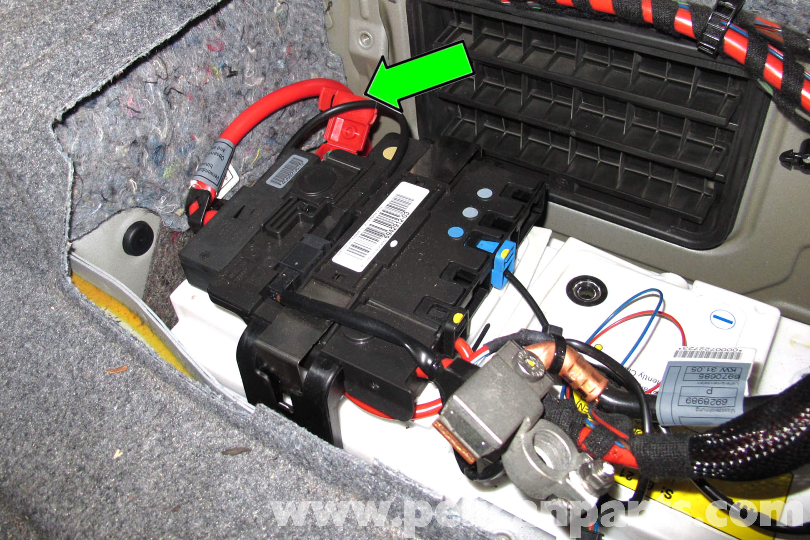 pic06 bmw e90 battery replacement e91, e92, e93 pelican parts diy 2006 bmw 330i fuse box diagram at crackthecode.co