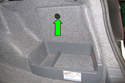 Working in trunk, twist trim panel lock counterclockwise then open and remove trim piece.